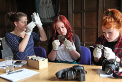 Examining lantern slides, Hall Place Museum